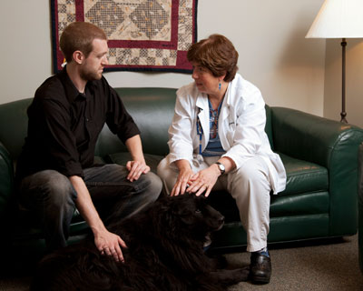 doctor having a conversation with pet owner